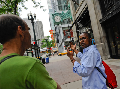 A Greeter shows a group of visitors her must-sees in Chicago.