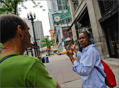 A Greeter shows a group of visitors her must-sees in Chicago